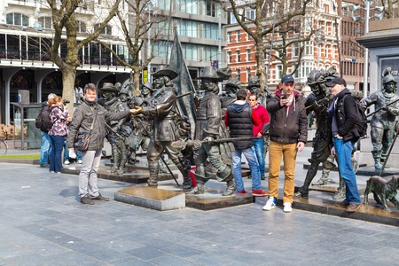 rembrandt: Amsterdam, Netherlands - March 31, 2016: Tourists posing for photo near Night Watch by Rembrandt in Rembrandtplein, Amsterdam, Netherlands