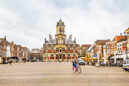 delft: Delft, Netherlands - April 8, 2016: Stadhuis or City Hall at Markt square, houses, people in Delft, Holland