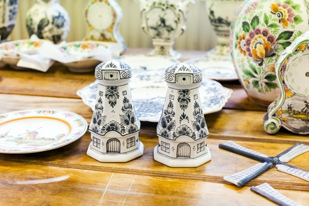 delftware: Delft, Netherlands - April 8, 2016: Pottery workpieces with hand painting of Delftware in the Delft pottery factory, Royal Delft Editorial