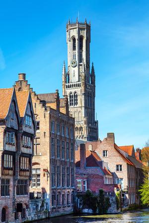belfort: Medieval tower Belfort against blue sky in Bruges, Belgium