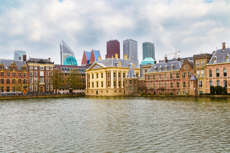 Famous parliament and court building Binnenhof and lake in Hague, Holland