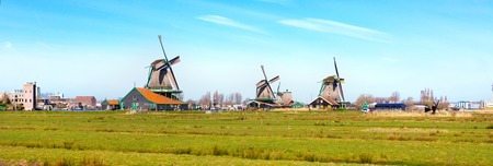 zaandam: Panoramic view of windmill in Zaanse Schans, traditional village in Holland, blue sky, copy space Stock Photo
