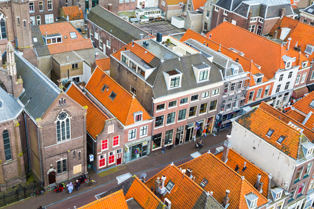 delft: Delft, Netherlands - April 8, 2016: Aerial panoramic downtown street view with houses in Delft, Holland