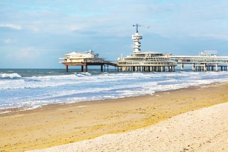 Scheveningen, Netherlands - April 7, 2016: North Sea beach and Scheveningen Pier near Hague, Holland, Netherlands