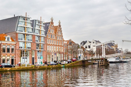 holland landscape: Haarlem, Netherlands - April 2, 2016: Picturesque landscape with beautiful traditional houses in Haarlem, Holland