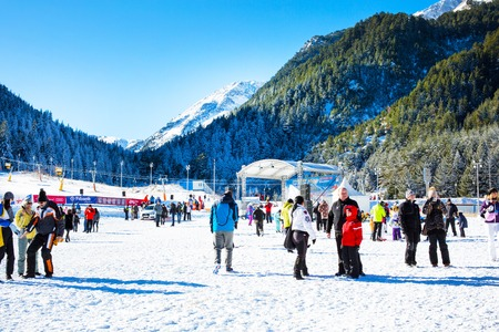 ski walking: Bansko, Bulgaria - December 12, 2015: Ski resort Bansko, ski slope with people walking and skiing