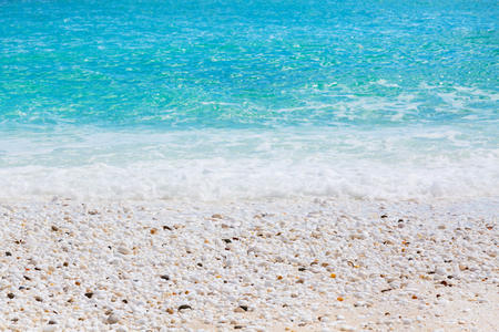 thassos: Summer vacation background texture of Saliara aka Marble Beach stones and waves in Thassos Island, Greece and turquoise water wave Stock Photo