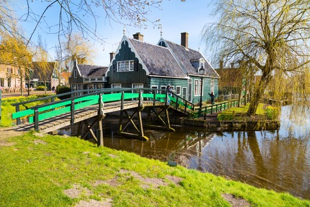 zaanse: Zaanse schans, Netherlands - April 1, 2016: Zaanse Schans, Holland traditional village houses and bridge