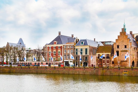 'the hague': Hague, Netherlands - April 5, 2016: Street view with dutch houses and lake in Hague, Holland Editorial