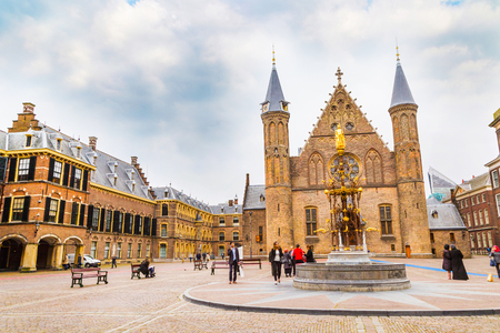 the hague: Hague, Netherlands - April 5, 2016: People near Binnenhof palace, place of dutch parliament in Hague or Den Haag, Holland, Netherlands Editorial
