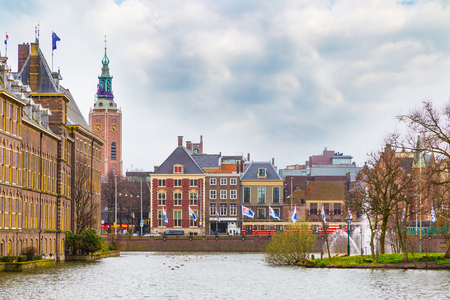 Hague, Netherlands - April 5, 2016: Street view with dutch houses, clock tower and lake in Hague, Holland Editorial