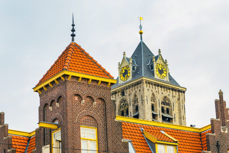Old traditional dutch house brick clock tower closeup in Hague, Holland