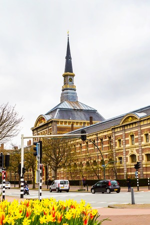 the hague: Hague, Netherlands - April 5, 2016: Royal Stables with clock tower and street view in Hague, Netherlands Editorial