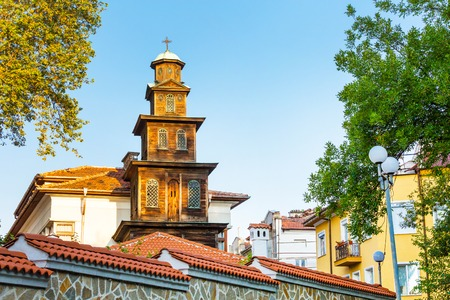 Old wooden St. Marina church bell tower in Plovdiv, Bulgaria against blue sky