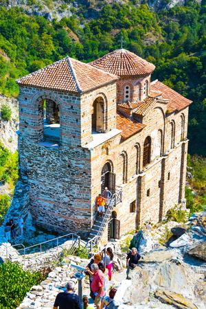 assen: Asenovgrad, Bulgaria - September 4, 2016: Saint Mary church at Asens Fortress near Asenovgrad, Bulgaria and tourists