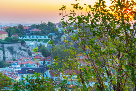 amphitheatre: Sunrise Plovdiv aerial skyline panorama, Bulgaria with Roman amphitheatre tower and houses