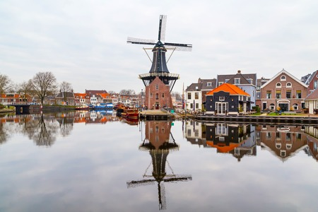 Picturesque landscape with the windmill and traditional houses, Haarlem, Holland