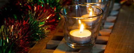 tea candles: Christmas eve banner background with tea candles and Christmas decorations