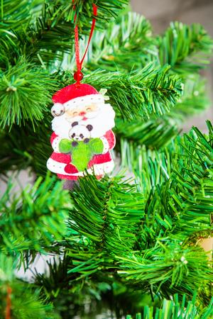 christamas: Closeup Santa Claus Christmas tree decoration holiday New year card Stock Photo
