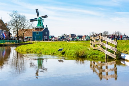 zaanse: Zaanse schans, Netherlands - April 1, 2016: Panoramic view of windmills in Zaanse Schans, traditional village in Holland Editorial