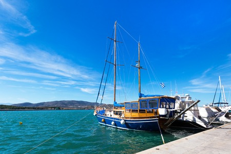 Volos, Greece - October 13, 2016: Sailing ships and yachts stand moored in the port of Volos, Greece Editorial