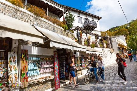 historic place: Makrinitsa, Greece - October 11, 2016: Street and shops view at Makrinitsa village of Pelion, Greece