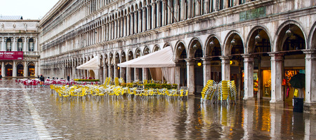 Venice, Italy - November 10, 2014: Cafe at San Marco square in Venice flooded from high water