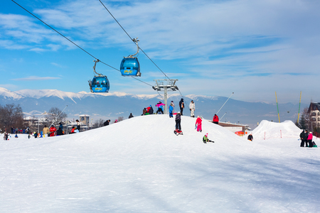 ski walking: Bansko, Bulgaria - January 13, 2017: Winter ski resort Bansko, attractions, people walking and skiing and mountains view Editorial