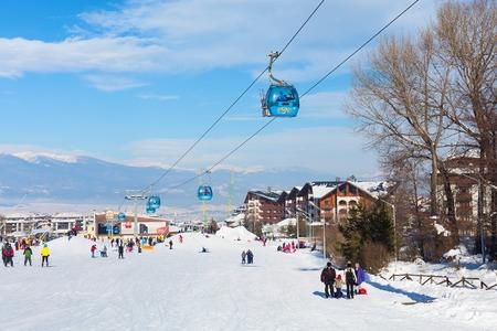 Bansko, Bulgaria - January 13, 2017: Winter ski resort Bansko, ski slope, people skiing and mountains view Editorial