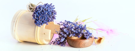 aroma bowl: Making aroma bags, bunch of dry wild mountain lavender flowers and wooden bowl banner background Stock Photo