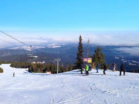 ski slopes: Borovets, Bulgaria - January 30, 2017: Panorama of winter mountains, skiers on ski slopes in bulgarian alpine ski resort Borovets Editorial