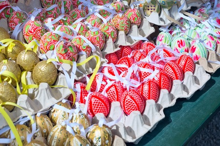 eastertime: colorful painted easter eggs in basket at the traditional European market Stock Photo