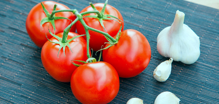 Fresh organic garlic and tomatos, food banner background