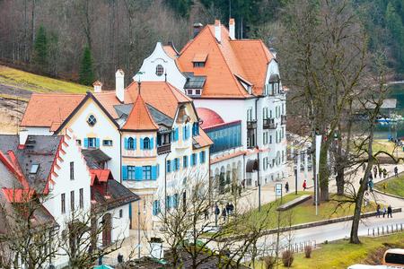 neuschwanstein: Beautiful traditional bavarian houses aerial street view near Neuschwanstein and german alps in Bavaria