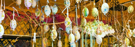 eastertime: Colorful painted yellow Easter eggs on the tree at the traditional European market