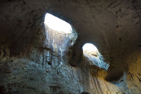 eyes cave: The Eyes of God in Prohodna Cave, famous cave in Karlukovo, Bulgaria Stock Photo