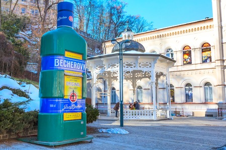 Karlovy Vary, Czekh Republic - February 15, 2017: Street view, big Becherovka bottle and hot spring in the center of famous spa town