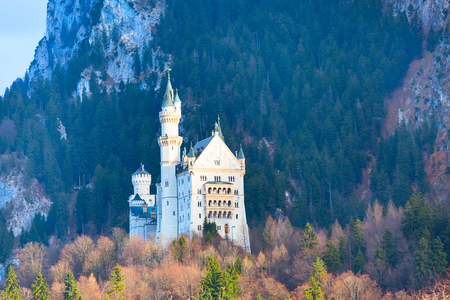 neuschwanstein: Neuschwanstein Castle the famous castle in Germany located in Fussen, Bavaria, mountains and blue sky Stock Photo