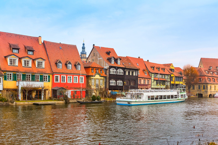 bayern old town: Bamberg city center view with river, half-timbered colorful houses on water and boat