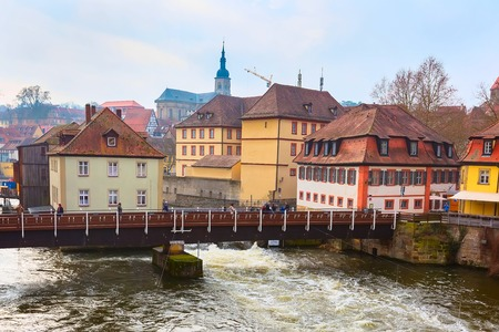 bayern old town: Bamberg city center street view with houses and bridge over the river
