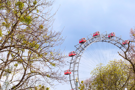 Prater Ferris Wheel, icon of Vienna, Austria among spring green trees