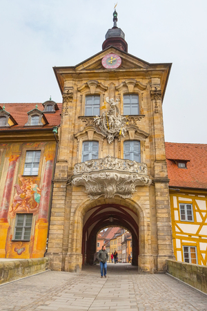 bayern old town: Bamberg, Germany - February 19, 2017: Icon of Bamberg Obere bridge or brucke and Altes Rathaus town hall city center, people