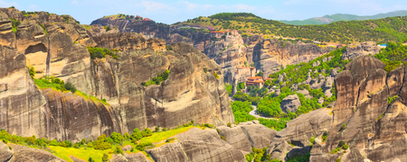 Panoramic banner view of Meteora monasteries on the high cliff rocks, Greece Stock Photo