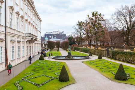 wolfgang: Salzburg, Austria - December 25, 2016: Green flowerbed garden and Hohensalzburg Festung in Salzburg, Austria