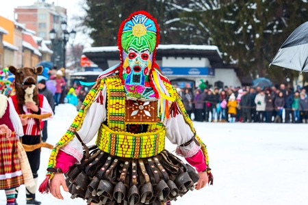 Razlog, Bulgaria - January 14, 2017: People in traditional carnival kuker costumes at Kukeri festival Starchevata