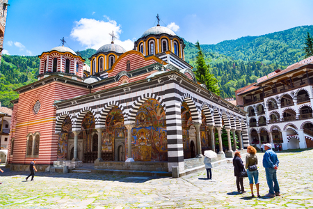 Rila, Bulgaria - June 25, 2015: People near the church in Rila monastery, Rilsky monastery or Monastery of Saint Ivan of Rila Redakční
