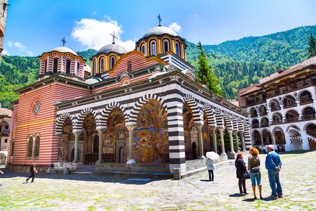 Rila, Bulgaria - June 25, 2015: People near the church in Rila monastery, Rilsky monastery or Monastery of Saint Ivan of Rila Editorial