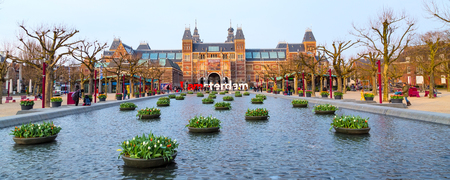 holland: Amsterdam, Netherlands - March 31, 2016: Rijksmuseum and people in front of writing I amsterdam at Museumplein, Holland Editorial