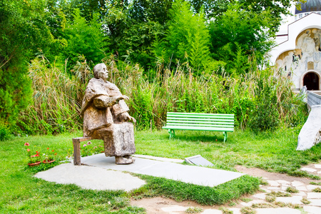 Famous bulgarian medium Baba Vanga statue in Rupite village and part of the church