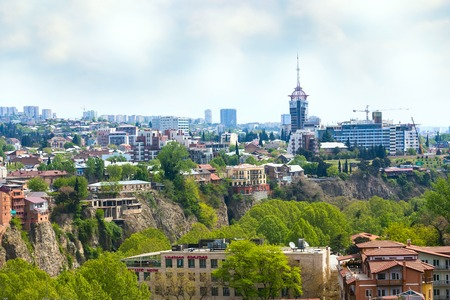 Tbilisi, Republic of Georgia - April 29, 2017: Aerial skyline view with old traditional and modern houses Editorial